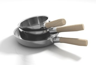 The Shiba collection frying pans are made of stainless steel with either wood (shown) or bakelite handles.