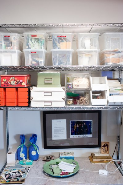 Lynda's knick knacks and crafty supplies are kept in the kitchen's metal shelving system, which came with the couple from their previous apartment.