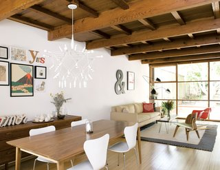 The couch and dining room table are from Room & Board; the Patrick Townsend Orbit Chandelier is from Velocity Art and Design.