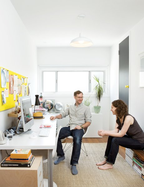 What was once a storage space is now a sun-drenched home office where the couple writes emails and stores their design magazines. The jute rug is from West Elm; the desk is a door on Ikea legs.