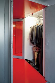 A specialty hanging system was created for a long, narrow closet.