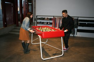 Guests at the event face off on one of RS Barcelona's new foosball tables.