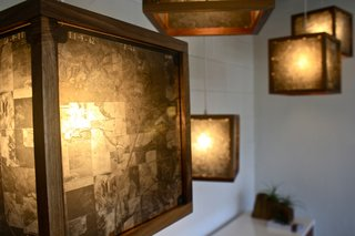 """These hanging lights are framed in walnut and made from original 1960's glass negatives of the Texas landscape taken from a survey plane,"" says Rob McGowan."
