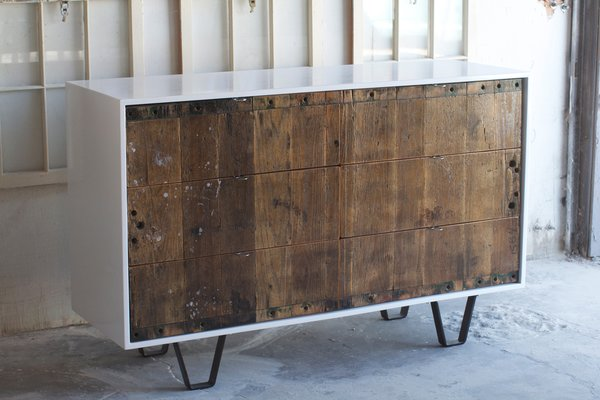 This console illustrates the contrast of old an new materials found in Fin Art's work. One of their influences is Brooklyn-based furniture maker Palo Samko, who has a similar aesthetic.