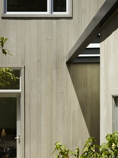 Tongue-and-groove wood siding will often create a smooth surface, because the interlocking edges are hidden. Without the shadow lines from other types of siding, this house employed varying widths of a cedar siding to create a subtle pattern.