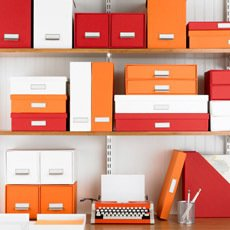 Container Store Stockholm storage boxes in orange, $9.99 each.