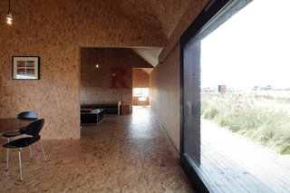At a fraction of the size of Ochre Barn, Stealth Barn is just one clear shot down the hall from the kitchen to the bedroom. OSB is an even stronger part of the interior here evoking bales of hay.
