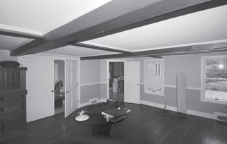 "Trim Beam<br><br>""The most difficult part of combining the living and dining rooms was that the 'fake' Colonial ceiling beams in the dining space""—which took the already-low seven-foot ceilings down to a head-scraping six feet four inches—""turned out to be structural,"" says Bardt. Working with an engineer, he and Leski ""shaved down"" the beams and reinforced them to achieve a uniform ceiling height ""without tearing the house apart."""