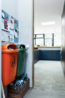 Bring In the TrashWith an eye for the industrial, Winterhalder built the garbage area in the kitchen around two standard-issue plastic trash cans common in German cities. One is orange; the other, green. These in turn inspired her to start adding color accents around the house.