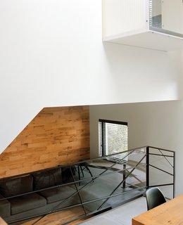 The kitchen overlooks the sunken living room, beneath the master bedroom.
