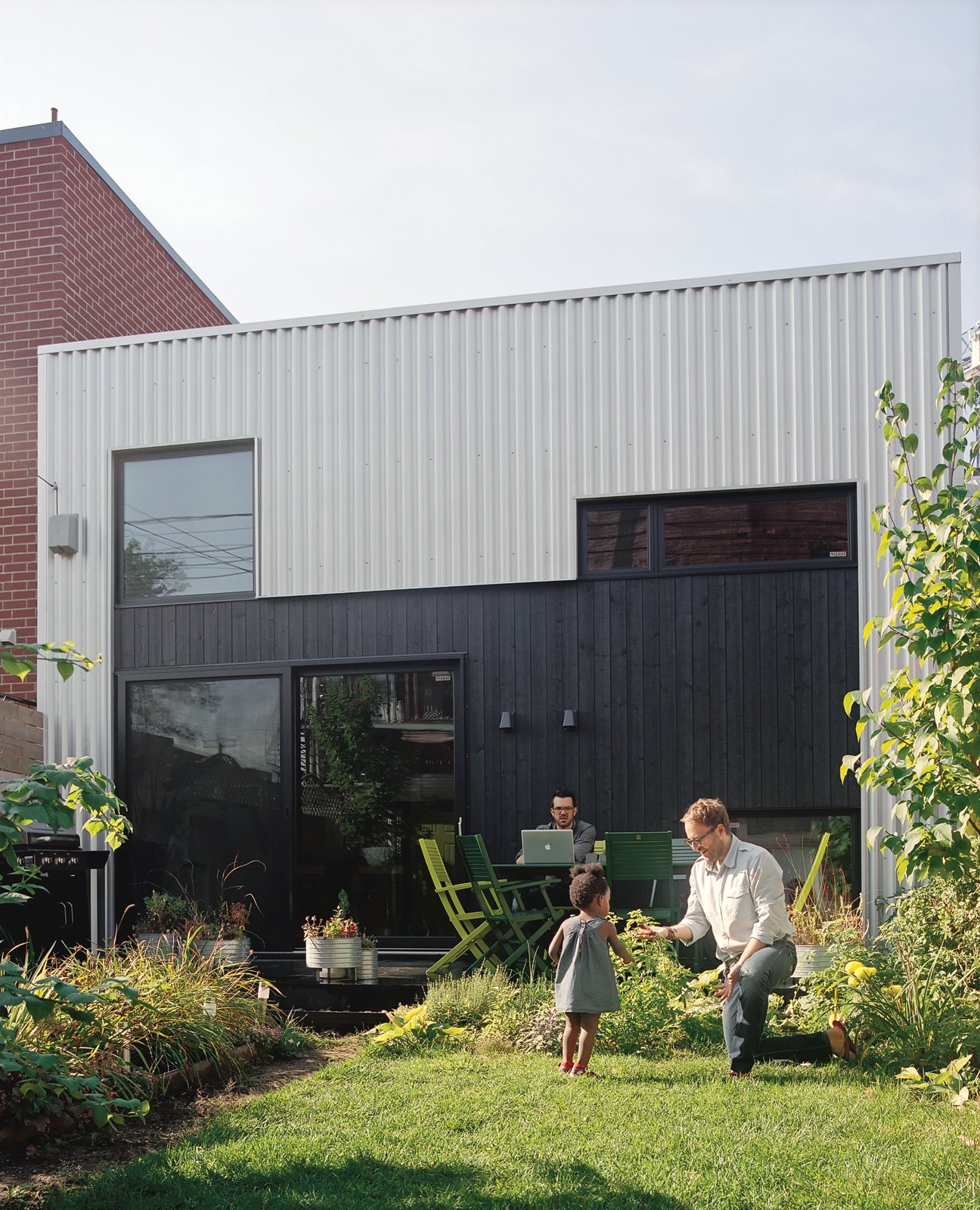 "Exterior, Metal Siding Material, and House Building Type ""Three things were clear when we started working with the architect: One, we had a limited budget; two, we had to plan for a kid; and three, every space had to be planned for—we didn't want extra space we didn't need.""—Francis Parisien  Photo 3 of 10 in Split the Difference"