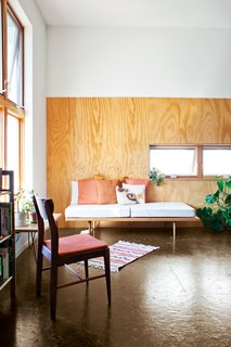 """A peek into two rental units reveals simple but strong interiors. The architects clad the walls with polyurethane-coated plywood """"to provide a durable and attractive finish and provide visual separation between the two levels in the high volume,"""" says Shelton."""
