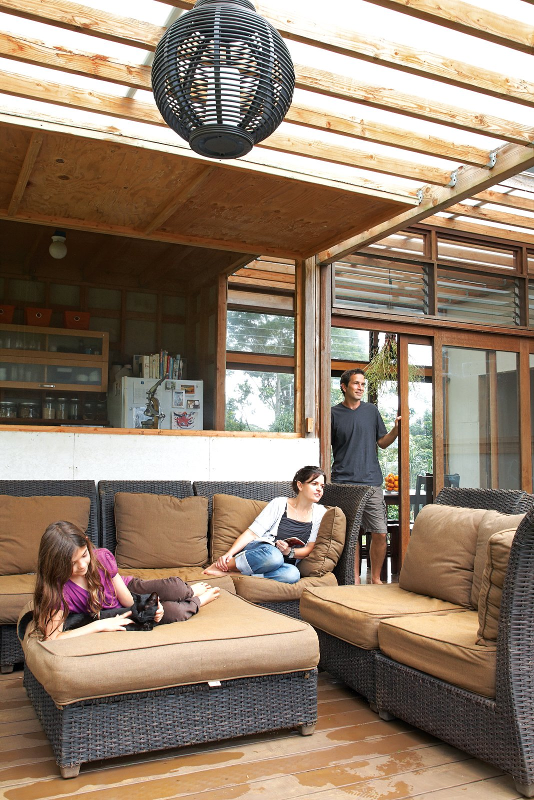Just off the kitchen is the lanai, which serves as the family's main gathering spot. The polycarbonate roof lets light through but keeps the rain at bay.  Photo 2 of 22 in Grateful Shed