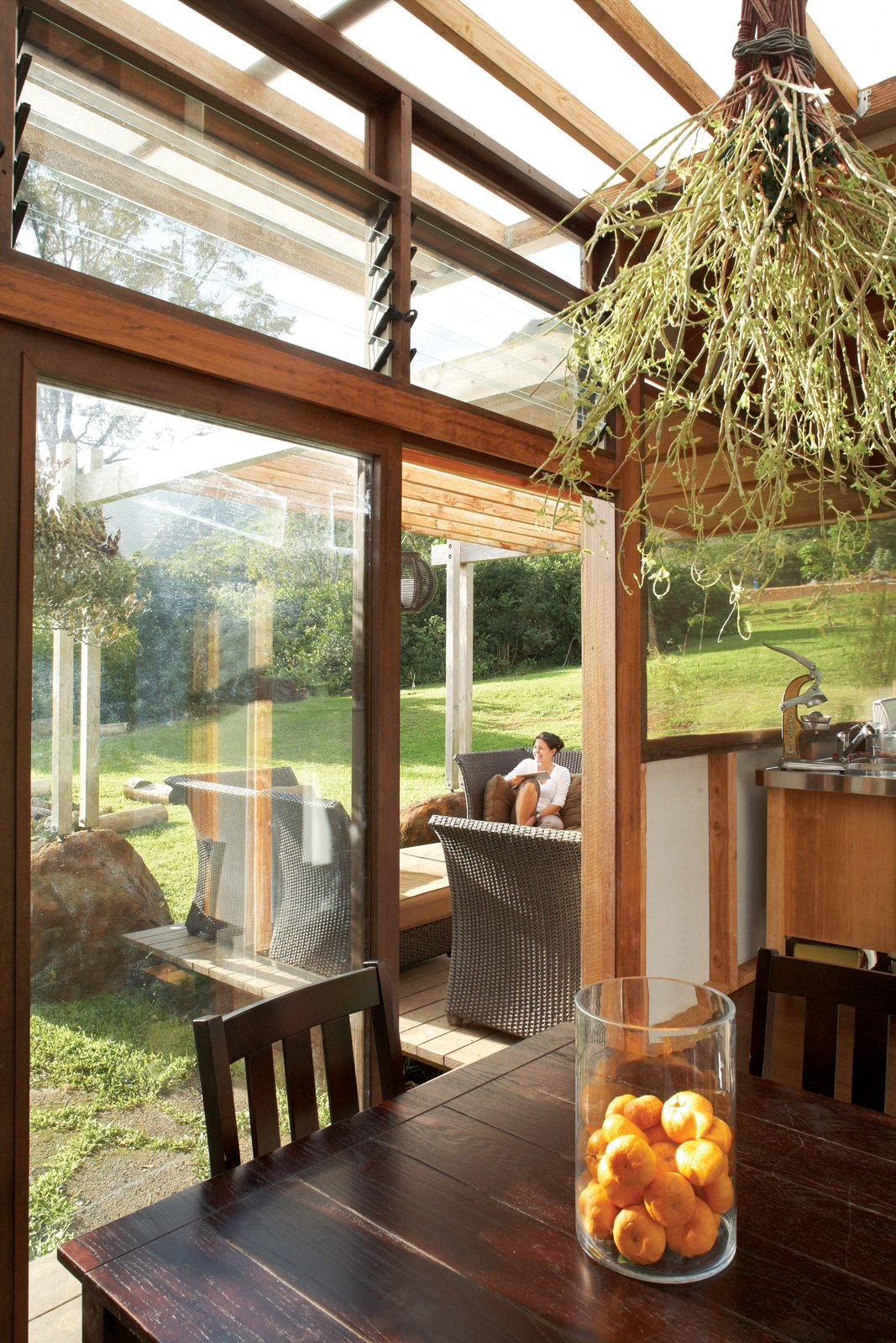The view from the dining area extends across the lanai to the lawn, which never needs watering—it stays   green from the island's frequent rains.  Photo 9 of 22 in Grateful Shed
