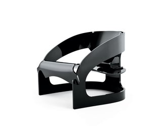 "The design has been reproduced in black, white, and crystal-clear plastic in the same proportions as Colombo's original, a process that Kartell treated with reverence, according to CEO Claudio Luti: ""We have been reluctant to approach re-editions because they may not be respectful of the original. This new chair is just the right balance between celebrating the past and making it topical in today's world."""