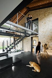 45 Pets in Beautiful Modern Homes - Photo 31 of 45 - Locally sourced Italian slate covers the ground floor rooms; the coat rack near the entrance is from Zanotta.