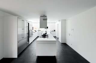 """""""We wanted a big kitchen to live in, not a small technical place to cook,"""" says Guido Chiavelli, who returns from work every day to have lunch with his wife and son. At the far end, a glass ceiling presents an open-air feeling. """"Cooking while it's raining is fascinating,"""" he says."""