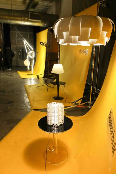 Dwell invited 14 designers to display work at the backdrop to the Light & Energy event. The set design was by Tom Borgese, who created photo vignettes in yellow for each design, unifying and warming the room at Industria SuperStudio.
