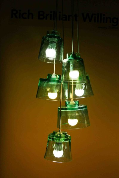 RBW's Bright Side Lights personifies a message of optimism through design and function. The cast glass pendants are durable, recyclable, and can be used as a hanging pendant lamp, or laid on their sides as a table lamp.
