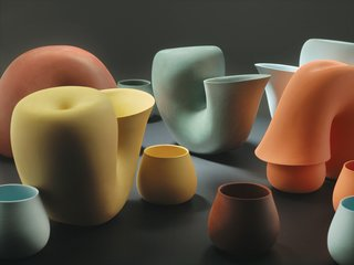 """Bakker's girlfriend, fashion and furniture designer Brecht Duijf, sometimes suggests colors for designs. """"I would not have been able to think of these colors,"""" Bakker says, holding up tiny ceramic chips she selected to determine the palette for Jug, a water carafe with a neck bent over a drinking cup, looking like a primordial creature feeding its young."""