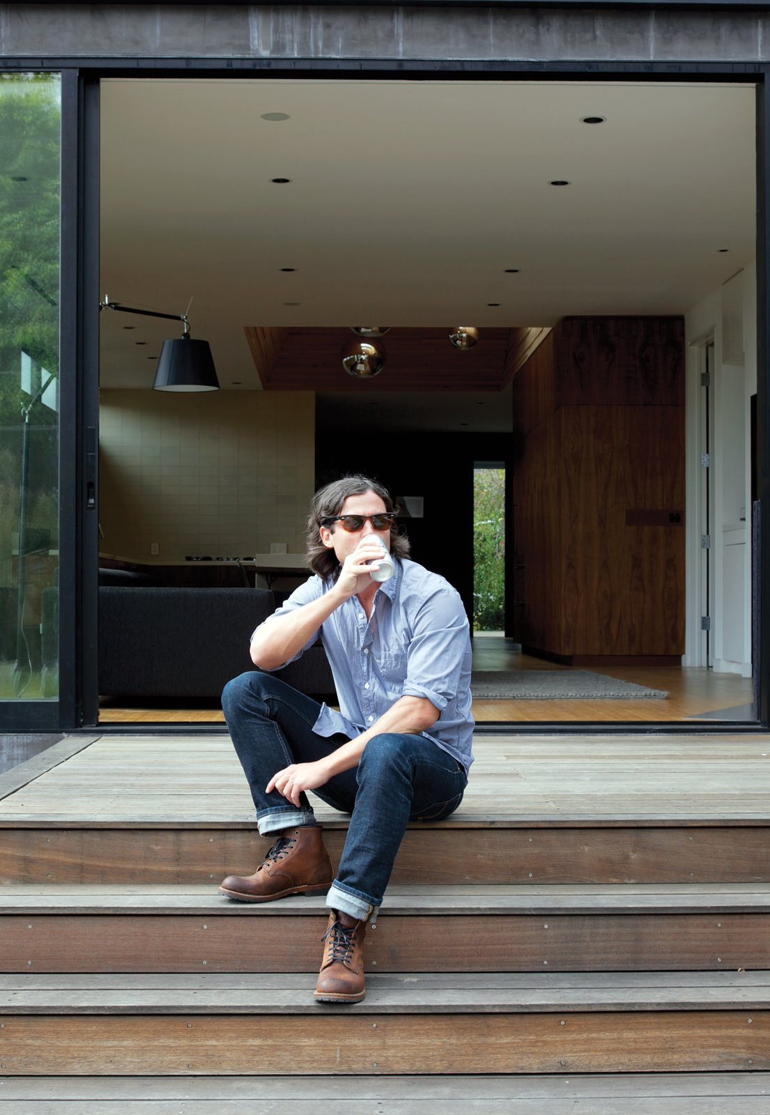 """Bill Thompson sits on his deck. Tagged: Outdoor, Wood Patio, Porch, Deck, Small Patio, Porch, Deck, and Decking Patio, Porch, Deck.  Photo 4 of 9 in You Won't Be Calling This House a """"Man Cave"""""""