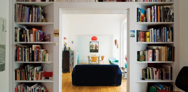 A view from Gadanho's home office and library and the apartment's entry hall typify the architect's interior approach: bright plus white.
