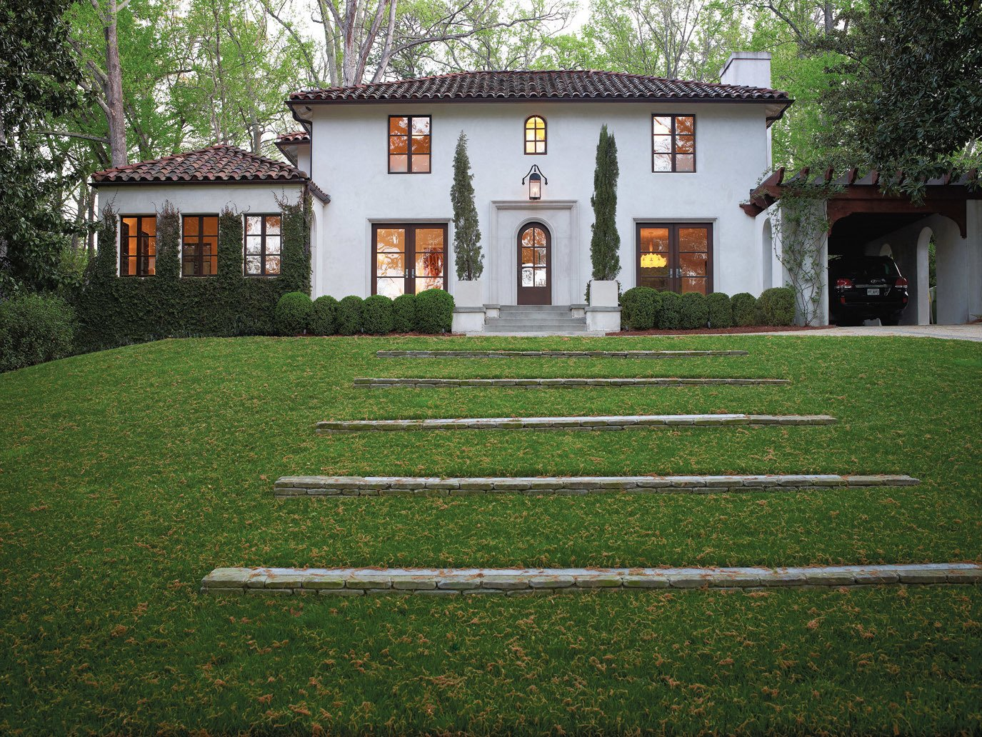 The family's 1920s Mediterranean-style manse is an eclectic example of the architecture found in Atlanta's elegant Buckhead neighborhood.  Photo 6 of 9 in A Designer Brings Her Bold Brand of Texas Modern to this Atlanta Family Home