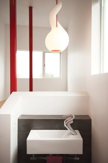 The Alien pendant light with red cord is by Constantin Wortmann for Next Design.