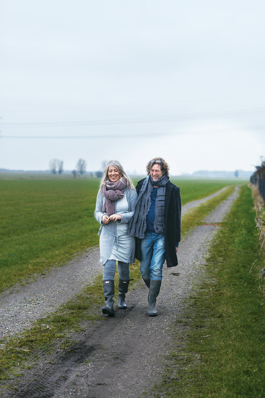 Leen and Middendorp walk down a path in Akkrum.  Photo 7 of 15 in Rural Home on a Holland Harbor
