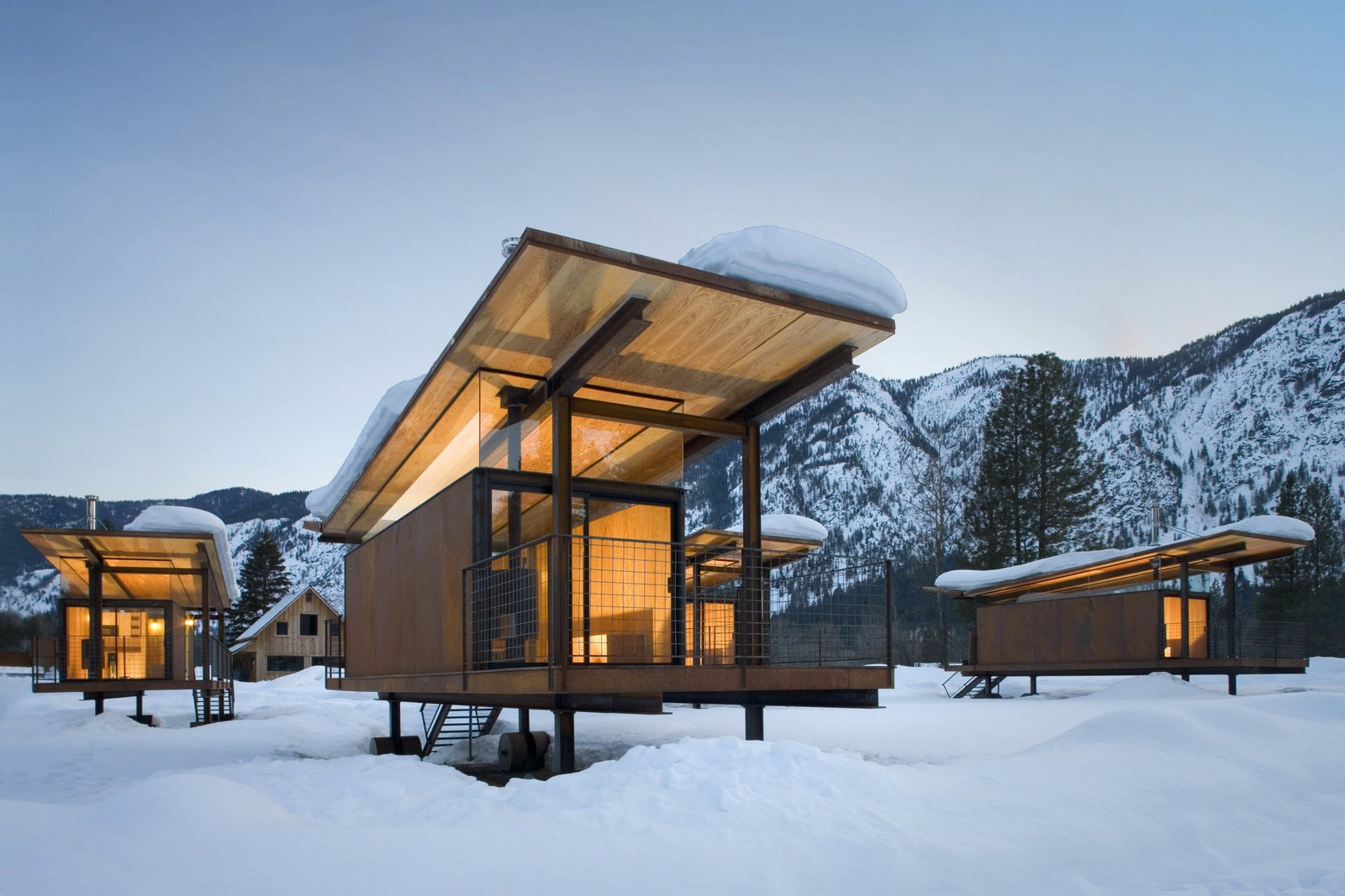Exterior and Cabin Building Type Olson Kundig designed the Rolling Huts in Mazama, Washington, for a client who needed space to house visiting friends and family. The huts sit lightly on the site, a former RV campground in an alpine river valley. The huts are sited to capture views of the mountains and not one another.  Photo 1 of 7 in In Omaha, an Exhibit Celebrates 50 Years of Olson Kundig