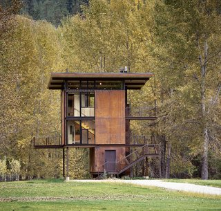 """This 1,000 square-foot weekend cabin in Mazama, Washington, is essentially a """"steel box on stilts,"""" according to the firm. The three-story structure, which includes a living room and kitchen, can be completely shuttered when the owner is away."""