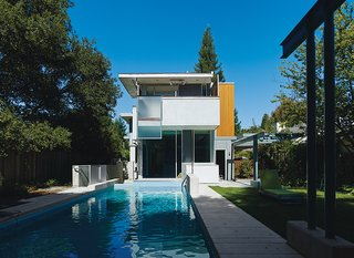 Architects Tom Chastain, Renee Chow, and Antje Steinmuller of Studio Urbis installed Swisspearl siding as a rainscreen and used concrete flooring and walls to insulate the home and regulate its internal climate.