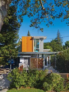 Movable wood screens on the exterior provide shade to alleviate heat gain. The home is color coded to correspond to the outside elements.