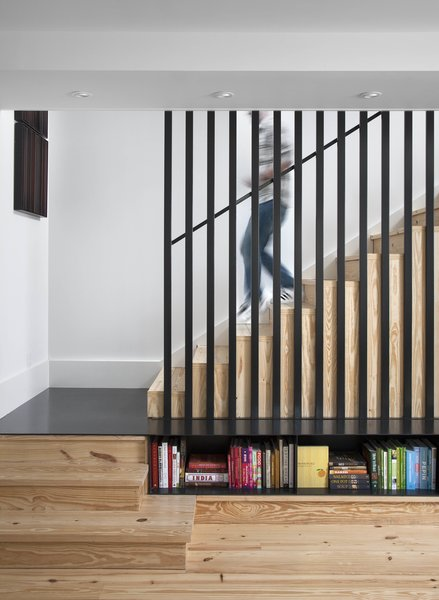"""Staircase and Wood Tread The caged staircase was designed by architect Patrick Ousey, with whom Flournoy collaborated in the home's design. Although initially unconvinced by the staircase detail, """"it is a great example of how collaboration brings in different perspectives,"""" says Flournoy.  Photo 8 of 8 in Modern Take on a Texas Farmhouse"""