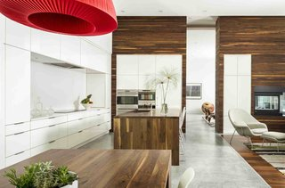 The kitchen counters and islands reflect a relatively simple material palette.