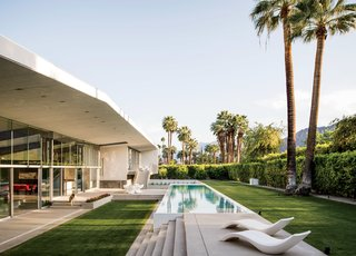 "A long and lean lap pool runs alongside the west facade of a hybrid prefab home in Palm Springs, California, by Sander Architects. ""Our version of prefab,"" explains architect Whitney Sander, ""involves the use of building shells that are the 'heavy lifting' parts of any house: main structure, secondary  structure, and (often) building skin."""
