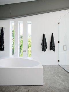 A Boffi tub is a defining feature in the master bath.