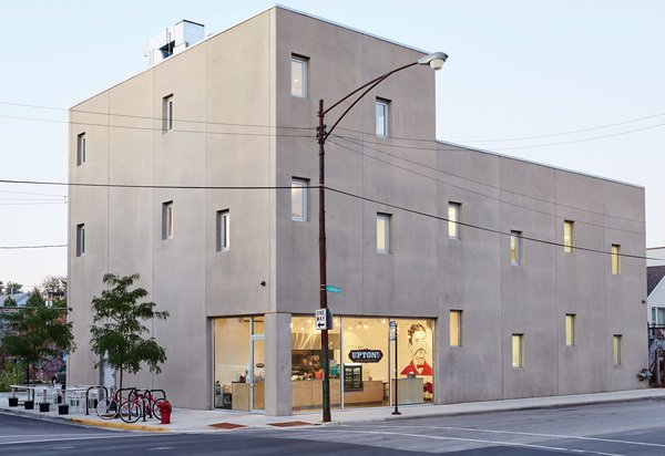 Located in the industrial pocket of West Town, UrbanLab's Martin Felsen and Sarah Dunn created a modern live-work building that serves both as a residence and production center for vegan food company Upton's Naturals. The Dukane Precast concrete panels were acid-etched for a more finished look.