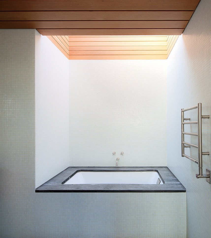Bath Room and Undermount Tub A large skylight looms above a Duravit tub and a Runtal Radia towel warmer in the en suite bathroom.  Photo 10 of 11 in Six Concrete Boxes Make a Jaw-Dropping Martha's Vineyard Home