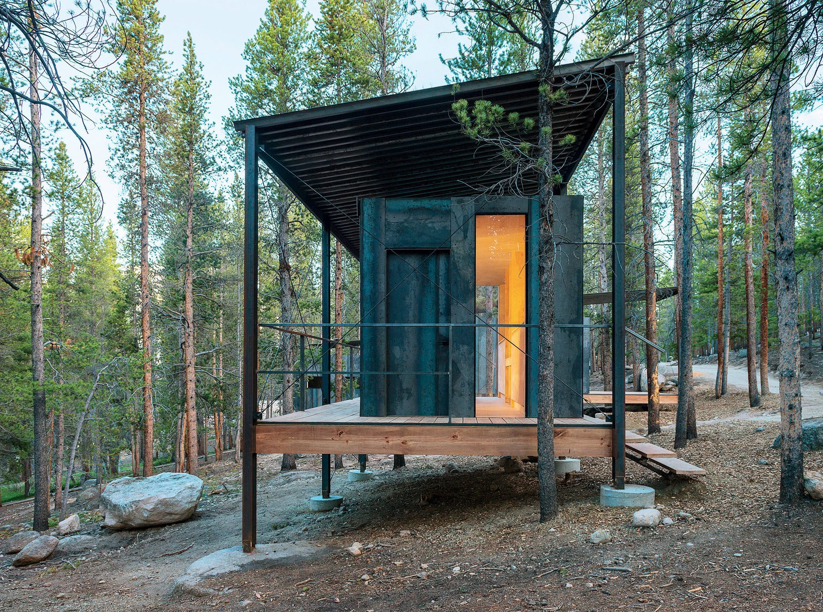 "Exterior, Cabin Building Type, Metal Siding Material, Shed RoofLine, Prefab Building Type, and Metal Roof Material The Outward Bound cabins' steel frames lift the structures above a three-foot snowpack while supporting corrugated-steel ""snow roofs.""  Photo 64 of 101 in 101 Best Modern Cabins"