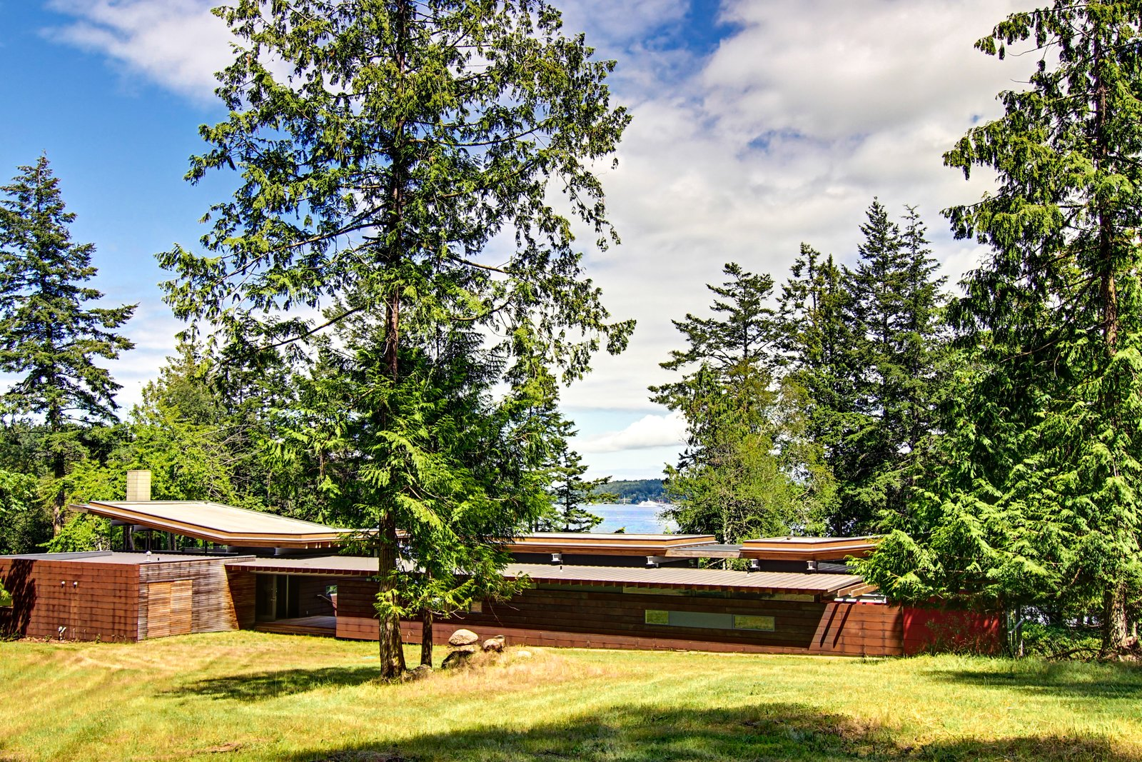 With its natural materials and horizontality, the house has a Wrightian vibe.  Photo 16 of 16 in An Off-the-Grid Island Home for a Seattle Music Producer
