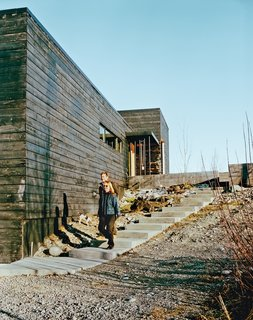 This Modern Cabin Is the Ideal HQ For a Family in Alaska - Photo 1 of 19 - A series of charred modern boxes, the home Petra Sattler-Smith and Klaus Mayer designed for Martin Buser and Kathy Chapoton, is organized around views of the Alaskan landscape.
