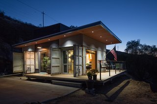 Mike McConkey, a superintendent for a general contractor, tasked Chris Bittner of OBR Architecture with designing an environmentally sensitive home for him and his wife in San Diego County. Utilizing three shipping containers and a bevy of cost-effective appliances, they managed to limit the budget to $160,000.