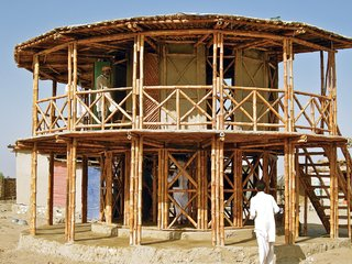 Yasmeen Lari - Photo 1 of 2 - In the aftermath of a 2005 earthquake in the Hazara and Kashmir regions of Pakistan, Lari came up with a bamboo shelter system called KaravanRoof that is designed with low costs and a low-carbon footprint. The structures are typically built with adobe-and-mud walls and strong bamboo cross bracing—all of which are raw materials available locally and suited to both rural and urban areas.