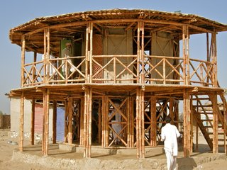 In the aftermath of a 2005 earthquake in Pakistan, Lari develeoped a bamboo shelter system called KaravanRoof, built with adobe-and-mud walls and strong bamboo cross-bracing.