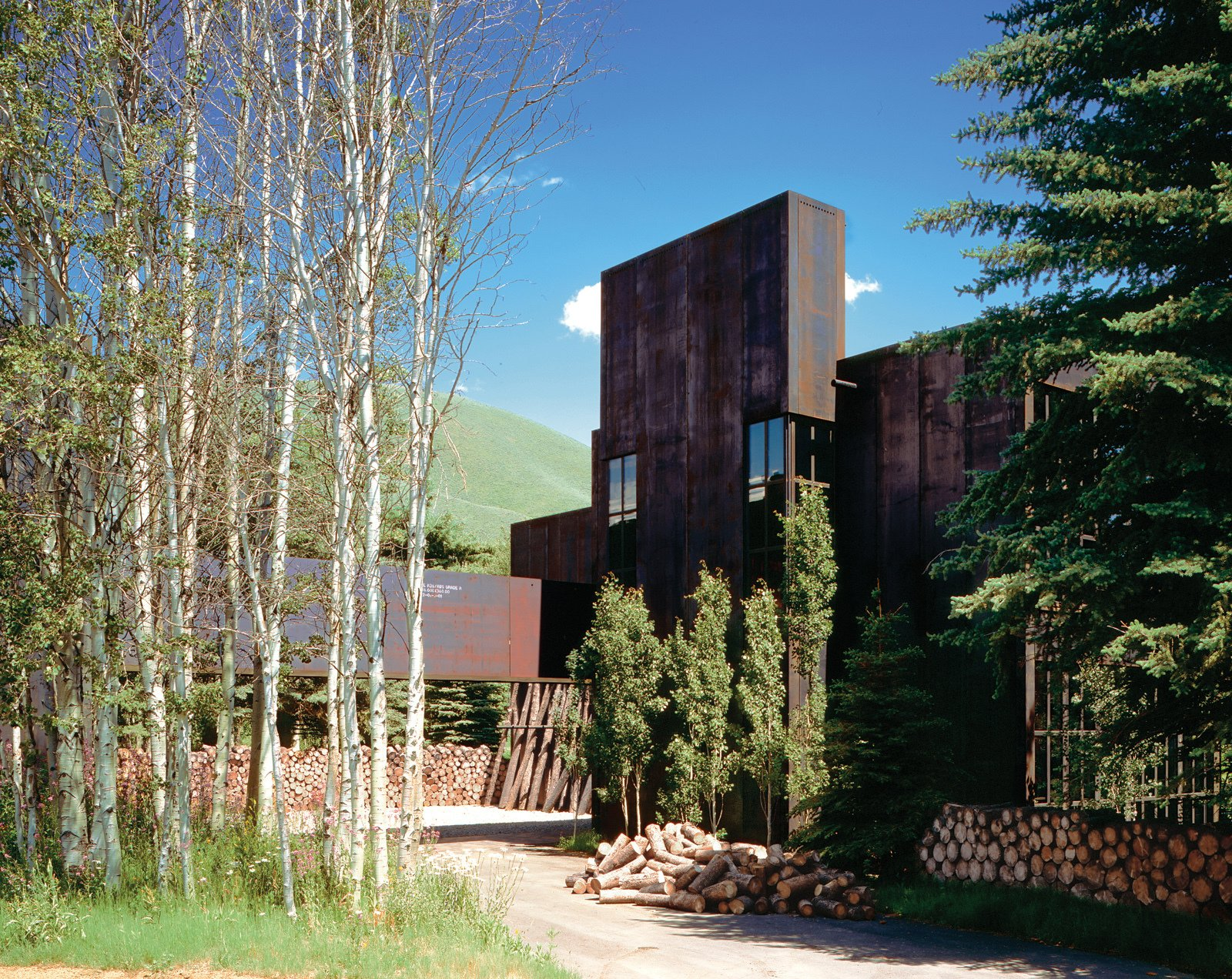 A steel-plate-clad house by architect Susan Desko in Ketchum, Idaho, features an untreated surface that changes color to reflect the sky.  Photo 3 of 3 in Facade Focus: Steel