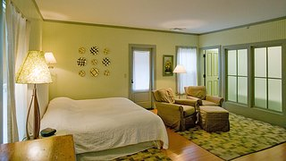 With four primary color schemes featured, headboard walls are painted terra cotta, pale blueberry, celery green, and sage green to complement wooden floors painted olive green, red, pumpkin and buttercup.<br><br>As part of her creative process Fitzpatrick conceptualized the design for each room by first establishing its color combination, and then matched vintage and modern pieces to accentuate the hues.