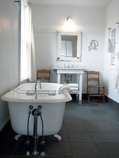 For a luxe evening soak, larger bathrooms (measuring 75-100 square feet) feature either Jacuzzi-style or claw-foot bathtubs with separate showers. The bathrooms also boast slate floors and distinctive touches like frosted glass and mirror frames salvaged from the building's original window frames. Bathrobes and towels hang from metal wall pegs reminiscent of 19th-century Shaker design.
