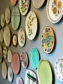 Part of an ongoing motif, vintage and thrifted plates are set up throughout the interior of rooms and in several of the hallways.
