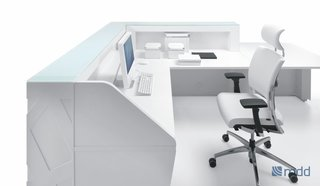 The high front panel of the desk allows for ample organization and a large interior work space.